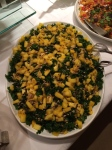 A remarkably healthy fix of massaged kale topped with fresh mango and sunflower seeds dressed with sweet and savory pepper-lemon vinaigrette