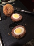 "A classic from 1700 Welsh coal mining days. Another special of ours, and a great ""bar food."" Hard boiled eggs, encased in sausage, breaded, and fried. Sliced and served with curry or chutney."